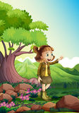 A female explorer at the rocky forest Stock Photo