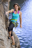 Female extreme climber conquers steep rock Royalty Free Stock Photo