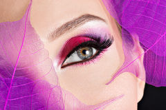 Female eye with  beautiful fashion bright pink makeup Stock Photo