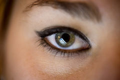 Female eye with computer screen reflecting in it Royalty Free Stock Photo