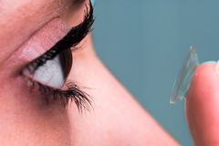 Female eye and contact lens Stock Photos