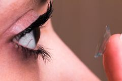 Female eye and contact lens Stock Images