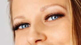 Female eye with extreme long false eyelashes. Eyelash extensions, make-up, cosmetics, beauty stock images