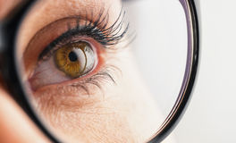 Female eye with glasses looks up - Vision concept image Royalty Free Stock Photo