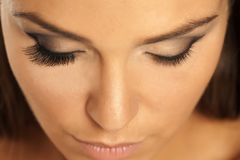 Eyelashes extensions. Female eye with and without lash extensions Stock Photography
