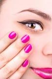 Female eye and manicure Royalty Free Stock Photo