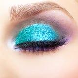 Female eye zone makeup. Close-up shot of young beautiful woman's eye zone make-up Stock Image