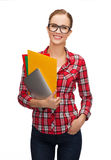 Female in eyeglasses with folders and tablet pc Royalty Free Stock Photo