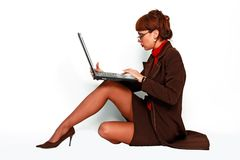 Female with eyeglasses working on lap top computer Stock Photo