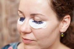 Female eyelashes dyeing with permanent paint Royalty Free Stock Images
