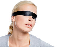 Female with eyes covered with black ribbon Stock Photos