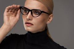 Female Eyewear Style. Beautiful Woman In Fashion Eyeglasses Royalty Free Stock Photo