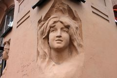 Female face, bas-relief, part of the wall Stock Image