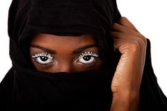 Female face in black scarf. Beautiful female face in black scarf showing eyes with white lashes Stock Photo