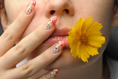 Female face close and nail art Stock Image