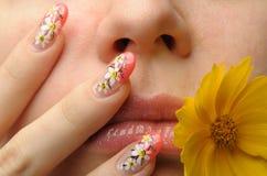 Female face close and nail art royalty free stock image