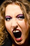 Female face close-up. With make up in glam rock style Stock Image