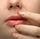 Female face close up and nail art Stock Images