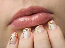 Female face close up and nail art Royalty Free Stock Photos