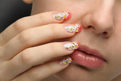 Female face close up and nail art Royalty Free Stock Image