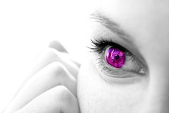 Female face with colored iris Stock Photo
