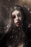Female face of dark horror. Eye of the black widow Royalty Free Stock Images
