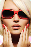 Female face in fashion red sunglasses Royalty Free Stock Photography