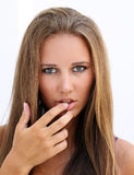 Female face with finger in mouth Stock Images