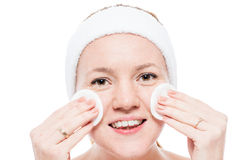 Female face with freckles and cleansing cotton pads close-up Stock Photography