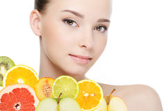 Female face with fresh fruits stock images