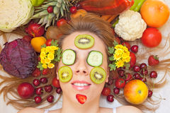 Female face with fruits and vegetables stock photo