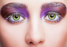 Female face with green pistachio colour eyes, evening violet pur Royalty Free Stock Photography