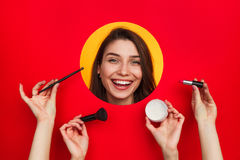 Female face and hands with cosmetics Royalty Free Stock Images