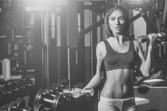 Female Face. Issues affecting girls. pretty sexy woman training with metallic dumbbells. Female Face. Issues affecting girls. pretty woman or cute girl with sexy Stock Photo