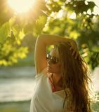 Female Face. Issues affecting girls. Woman face beauty. Girl with long blond hair pose under green tree. Female Face. Issues affecting girls. Woman face beauty Stock Photography