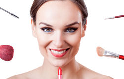 Female face and make-up brushes, tools and cosmetics Royalty Free Stock Image