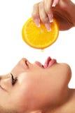Female face with orange slice Stock Photography