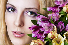 Female face with perfect skin and flowers Stock Image