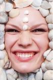 Female face with seashel Stock Photos