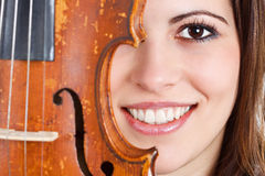Female face with violin Stock Photo