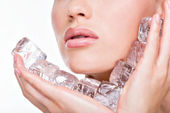Female face with water ice cubes at face royalty free stock photo