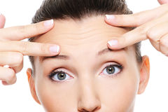 Female face with wrinkles on forehead Royalty Free Stock Photography