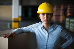 Female factory worker standing with hand on hip in factory Stock Photography