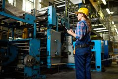 Female Factory Worker Supervising Quality of Production royalty free stock photo