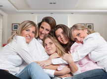 Female family sofa cuddle close Stock Photo