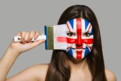 Female fan. Female supporter in national colors of Great Britain Royalty Free Stock Images