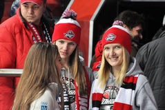 Female fans in caps with symbols team Donbass Stock Photos