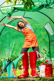 Female farmer and gardening tools in garden Royalty Free Stock Photos