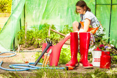 Female farmer and gardening tools in garden Royalty Free Stock Images