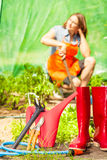 Female farmer and gardening tools in garden Royalty Free Stock Photo